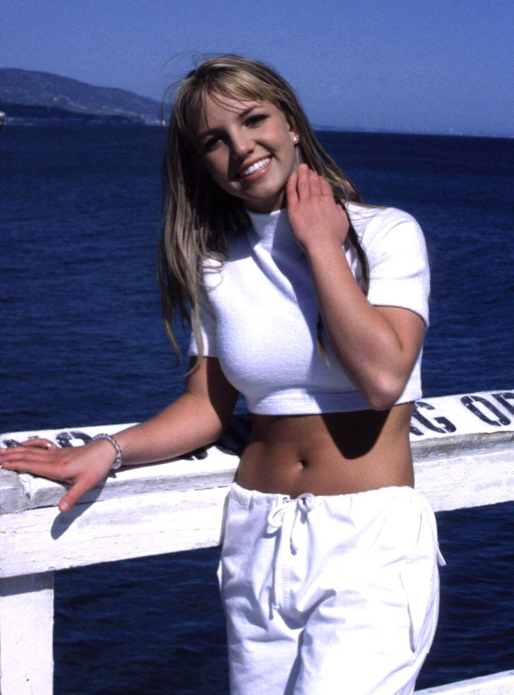 """Pin for Later: Great Moments in Crop Top History Britney Spears's """"Sometimes"""" Video in 1999 Sometimes she runs, sometimes she hides, sometimes she wears crop tops."""