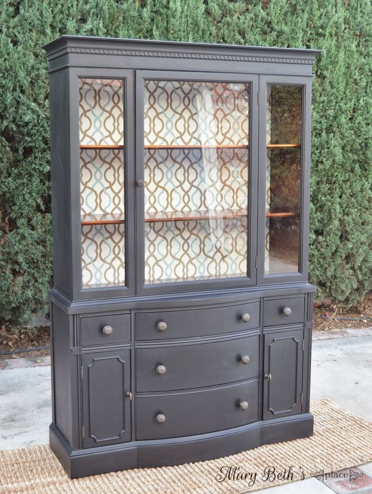 """Vintage china cabinet / hutch repurposed using General Finishes """"Lamp Black"""" . The back of the cabinet was lined with decorator fabric. For more information on this makeover, please visit my website!"""