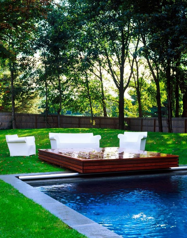 Novogratz country house backyard with pool deck for Outdoor pool backyard