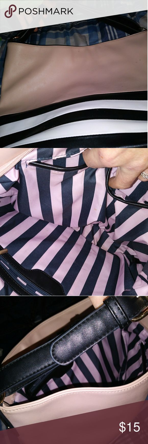 👛SALE! NWOT Pink,Blk,White Adjstbl Strap Purse 👛 SALE! NWOT flawless & super cute light pink w/black and white stripes at the bottom and in the fabric lining. One side has a zipper pocket & the strap is adgustable & the entire purse zips shut. The interior has 2 open pockets for make-up etc and zipper pocket. Super cute purse and a perfect size. Can be carried or worn on the shoulder. Gorgeous bag and pristine condition! Never worn once and kept in plastic. Bags Shoulder Bags