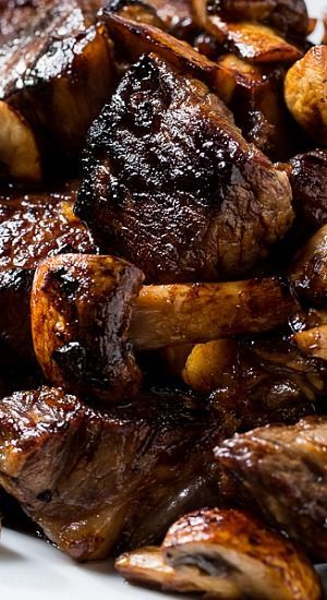 The steak is cut into bite-sized pieces and marinated in honey, brown sugar, garlic, bourbon, soy sauce, and Worcestershire sauce, plus some red pepper flakes for a little heat.