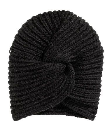 Black. Turban in a soft rib knit with a decorative knot detail at front.