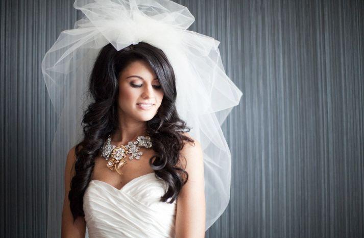 bride wears statement bridal necklace haute couture wedding veil