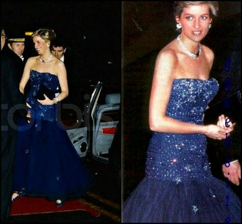 Long strapless, midnight blue gown. The skirt is made of tulle and lined with purple silk. The entire gown is decorated with daimant stars. Designed by Murray Arbeid. Diana first wore this gown to a party given by King Constantine of the Hellenes at Claridges in London in 1986. She also wore this to the Royal Opera House in London the following year, December 1987. This gown was again worn in an official royal portrait later on. Diana once paired this midnight blue gown with long, fuchsia…