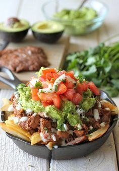 Carne Asada Fries - There's no need to go to San Diego for these fries. You can easily make this right at home, loaded with carne asada, guacamole, pico de gallo and sour cream!