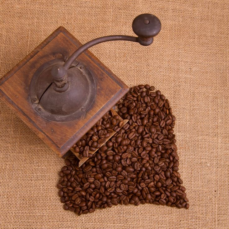 Photo Old coffee grinder and coffee beans by Antti Kallio on 500px