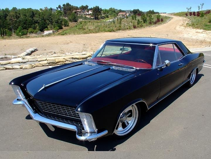 """1965 Buick Riviera  When in High School,I drove my parent's white 65 Riviera.  It had saddle leather seats, Teak wood interior trim, and a brass plate that read, """"Made Especially for Shannon Daily"""" (me) I loved that car!"""