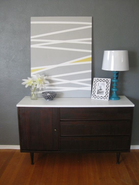 Another take on the DIY masking tape stripe art - paint a couple sections in an accent color.