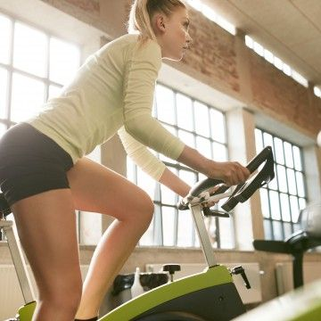 You Don't Need a Spin Class for This Stationary BikeWorkout   Daily Makeover