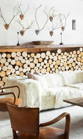 = leather, fur sofa, firewood stack and antlers