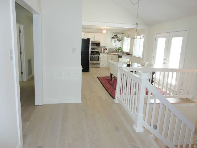 How We Updated Our 1970s House On A Budget Love These Before And After Pictures So Many Ideas Laminatefl White Wash Wood Floors Diy Wood Floors 1970s House