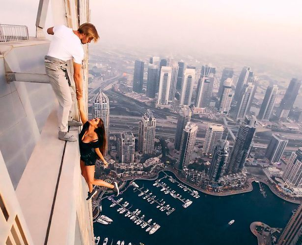 RUSSIAN MODEL SLAMMED FOR DEATH-DEFYING PHOTOSHOOT ON ONE OF THE WORLD'S TALLEST SKYSCRAPERS