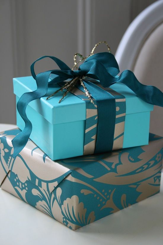 Use scraps of patterned paper to adorn the wrapping of another gift in a coordinating color. top with a matching ribbon. #giftwrap #ribbon