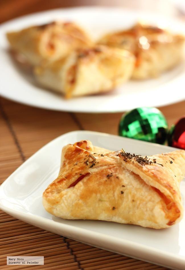 Receta de pañuelos hojaldrados de jamón, queso y piña. Con fotografías paso a paso, consejos y sugerencias de degustación. Recetas de aperitivos y entrantes