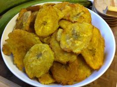Patacones {Panamanian Double Fried Plantains}. Recipe at www.foodandword.com