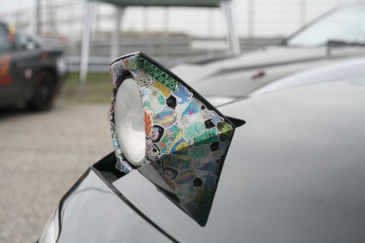 Miata headlight stickerbomb