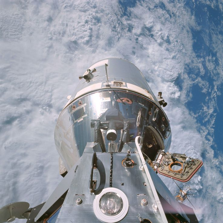 High above the Earth on March 6, 1969, a view of the Apollo 9 command/service module, photographed by Rusty Schweickart from the lunar module porch. You can see Dave Scott just inside the open hatch...
