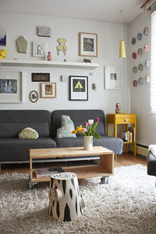 8 Stylish Ways To Decorate The Space Above Your Couch Wall Decor Living Room Apartment Decor Couches Living Room