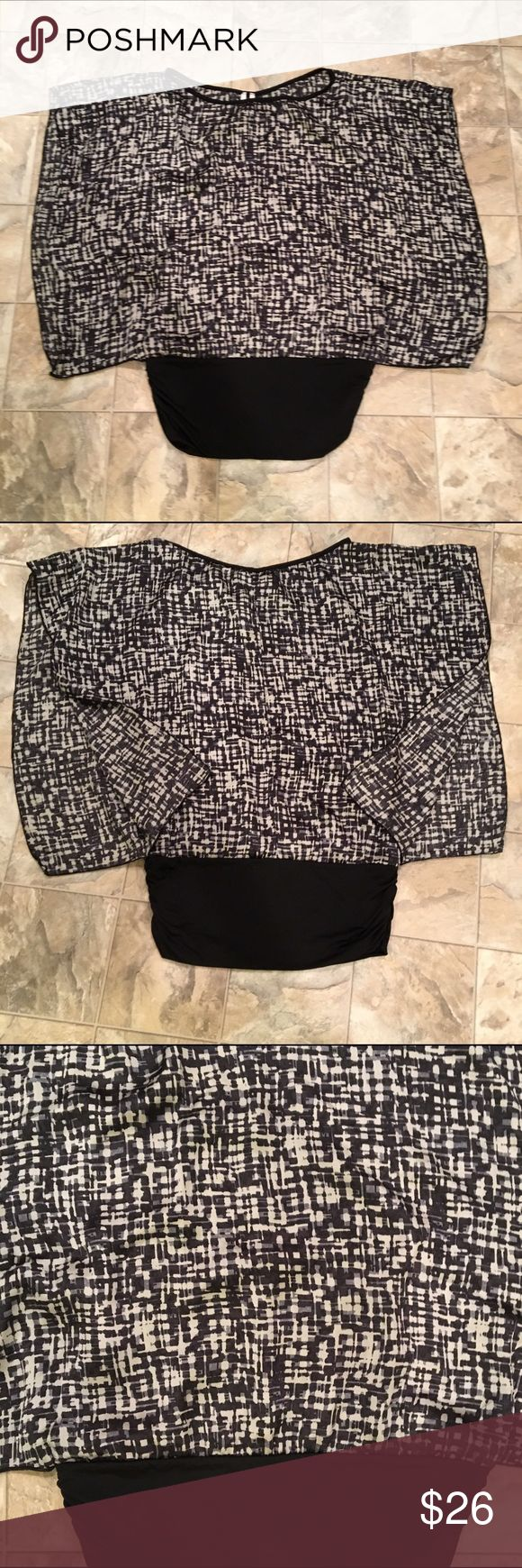Batwing style shirt Beautiful Batwing style top | black stretchy waist band | satin feel material with dark blue, black and and cream colored crosshatch pattern | no brand label | size S | sleeves open up as shown in second pic Tops