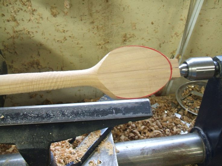 Turn a wooden spoon with an offset handle.