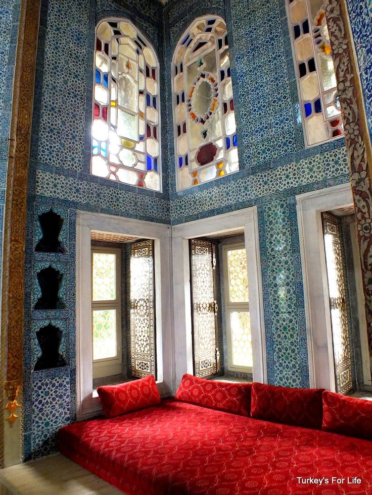 A classically appointed Topkapı Palace room, with the blue tiles and the colored-glass ornate window, a life of regal splendor and informed indulgence 500 years ago in Istanbul, the capital of the Ottoman Empire.