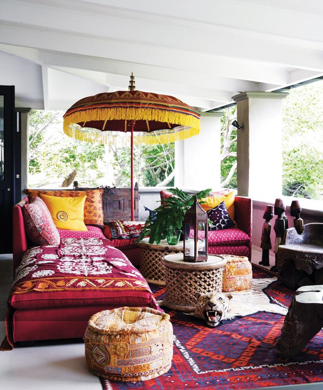 Eclectic ethnic mix on this South African veranda. For interesting exotic textiles and crafts try www.bringingitallbackhome.co.uk