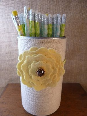 **Soup Can Pencil Holder. I like the way the cans look when they are wrapped in yarn/string.  I modified the decoration piece, and I glued it on instead of using a hairband.