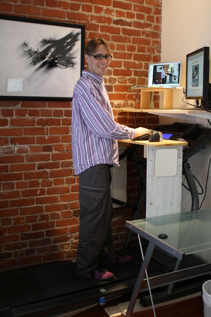 Make your own treadmill desk-simple as buying a used treadmill and mounting a shelf to a wall!  I need this!