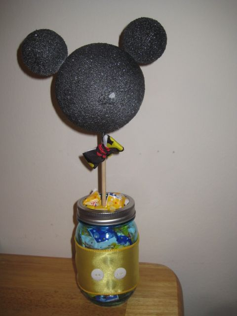 Center piece made from styrofoam balls (not budget friendly) Black glitter spray paint Mason jars Wooden sticks Ribbon of your choice Buttons Hot Glue Filler (I used candy)
