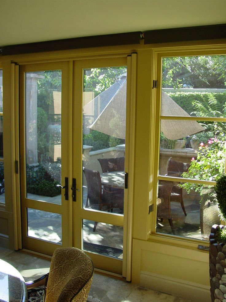Custom color stowaway invisible screen door for outswing for Retractable double screen door