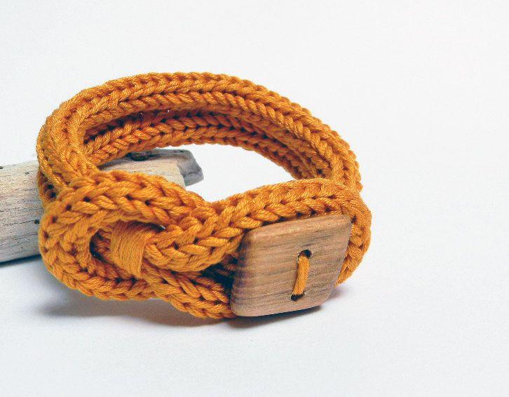 Knot bracelet, mustard yellow cotton bracelet. Square wood button, knitted jewelry. Knit bracelet, unisex. €20.00, via Etsy.
