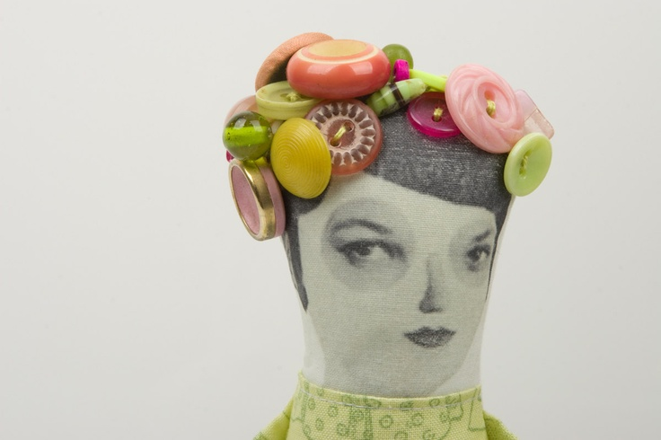Suspicious lady Wearing light green printed dress , blooming in Vintage Beads & Buttons hat - handmade cloth doll