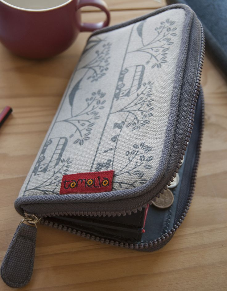Tamelia zip around wallet in Camping Print. 100% cotton canvas outer with divisions for 12 cards, paper money divider and coin zip pocket