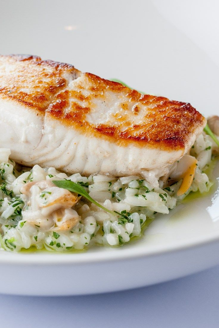 Dominic Chapman's sublime seafood recipe features a cockle infused risotto and perfectly cooked halibut fillet.