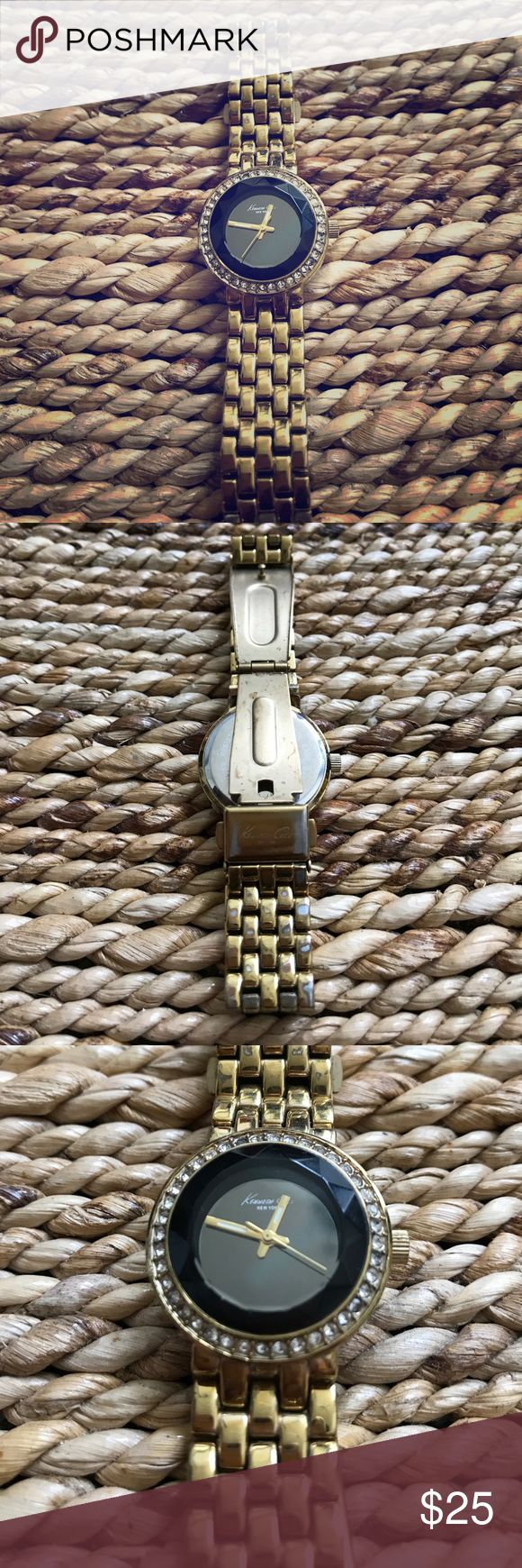 Kenneth Cole Ladies Gold Watch Classy Gold linked Watch with jeweled accented black face. Slightly worn on the bottom side of the Watch band. Battery still works! Kenneth Cole Accessories Watches