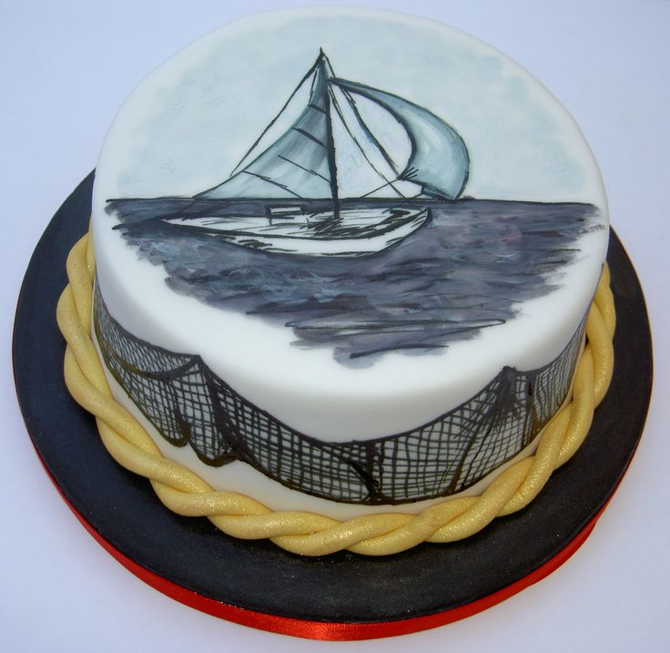 Sailing boat hand painted cake with fish net design.
