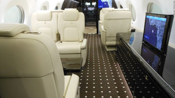 private jets - ONEflight - gulf-stream-g650 - The interior? Smooth, comfortable and sleek, with state-of-the-art connectivity. Buckle up! (via money.cnn.com)