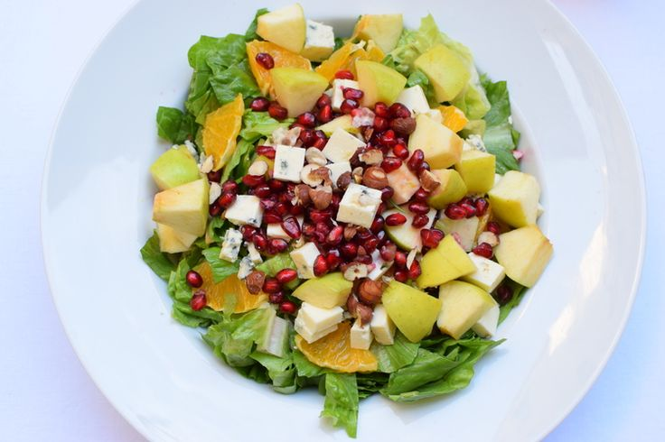 summer salad with pomegranate, apples, blue cheese, nuts and orange