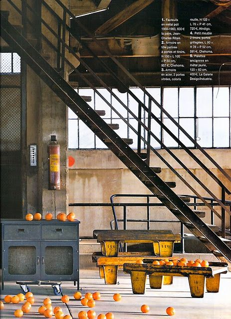 Create an illusion of rough surfaces and materials that suggest industrial past by leaving some walls or surfaces unfinished and add some rough metal elements.