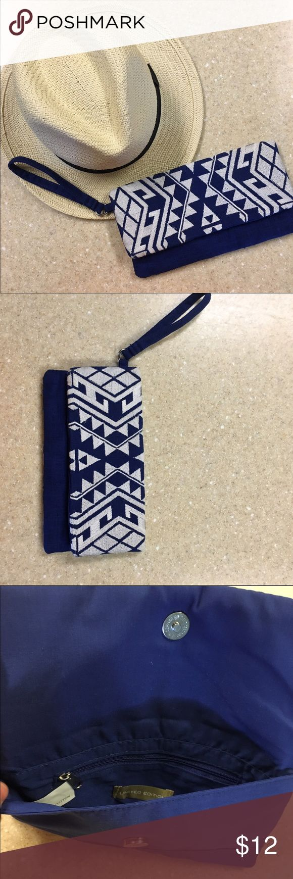 Blue and white clutch Super cute blue and white clutch. Never used. The material is cloth. Bags Clutches & Wristlets