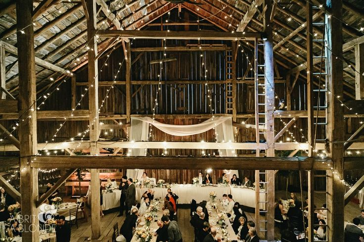 Lighting accents the beautiful architecture within the barn. Beautiful shot at Cambium Farms by A Brit and A Blonde!