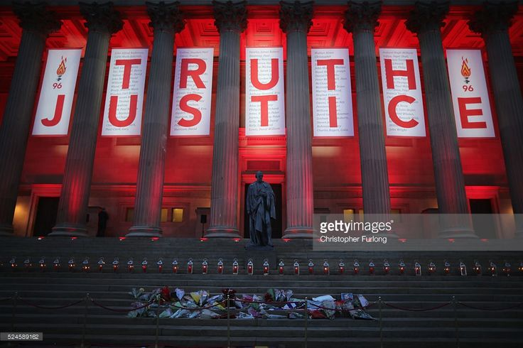 A banner reading Truth and Justice is hung from Liverpool's Saint George's Hall and illuminated in red after today's Hillsborough inquest verdict on April 26, 2016 in Liverpool, England. The fresh inquests into the 1989 Hillsborough disaster, in which 96 football supporters were crushed to death, concluded today on April 26, 2016 with a verdict of unlawful killing, after the initial verdicts were quashed. Relatives of Liverpool supporters who died in Britain's worst sporting disaster…