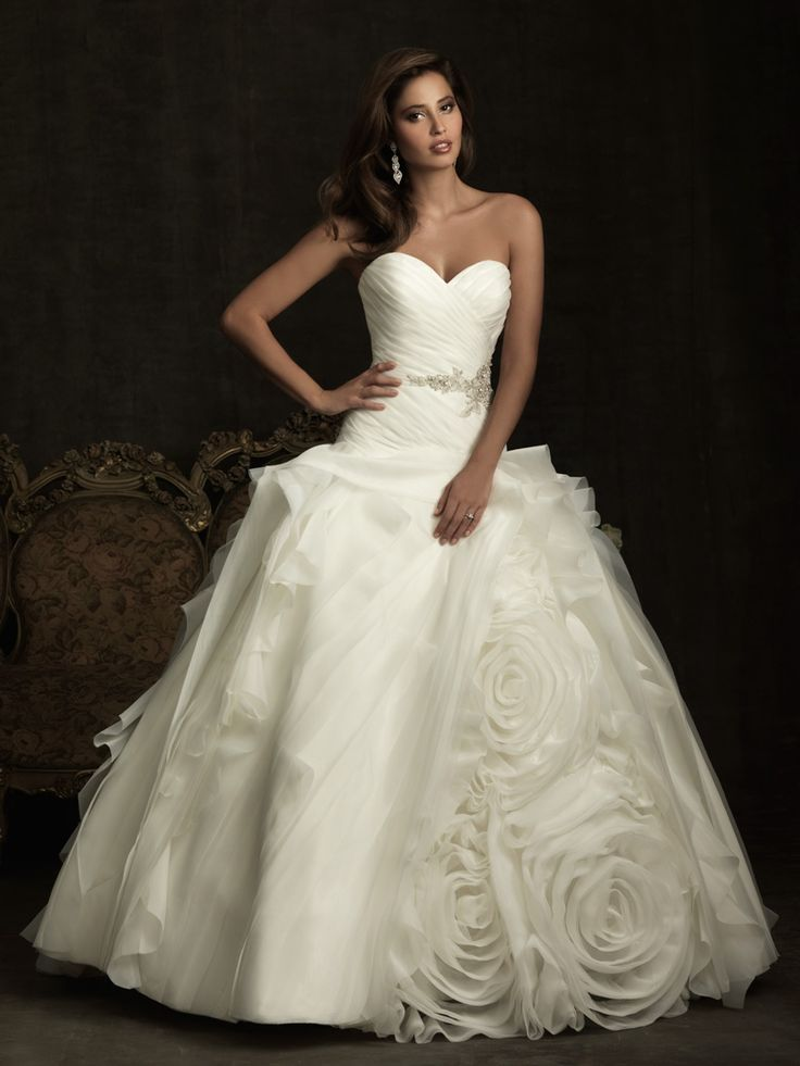 The ball gown with a statement with layers of ruffles and rosettes of organza and tulle