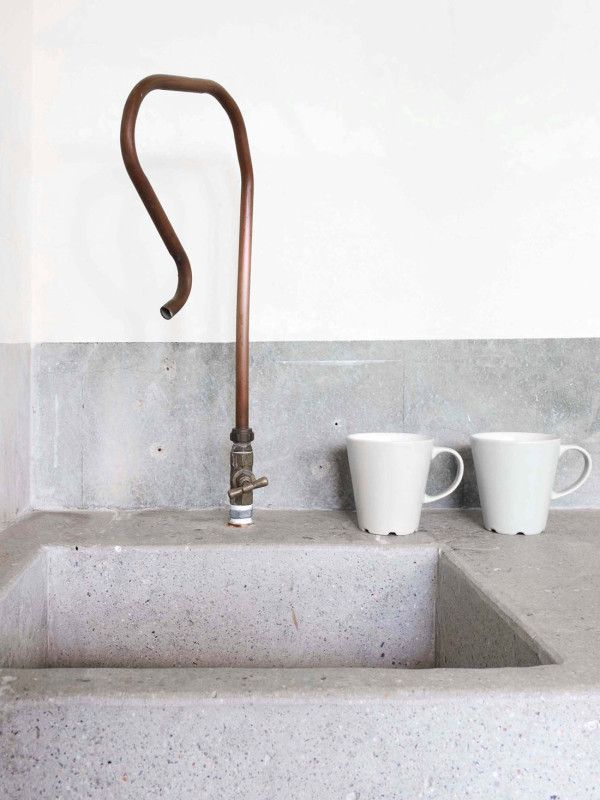 // concrete basin piping tap faucet copper white mugs