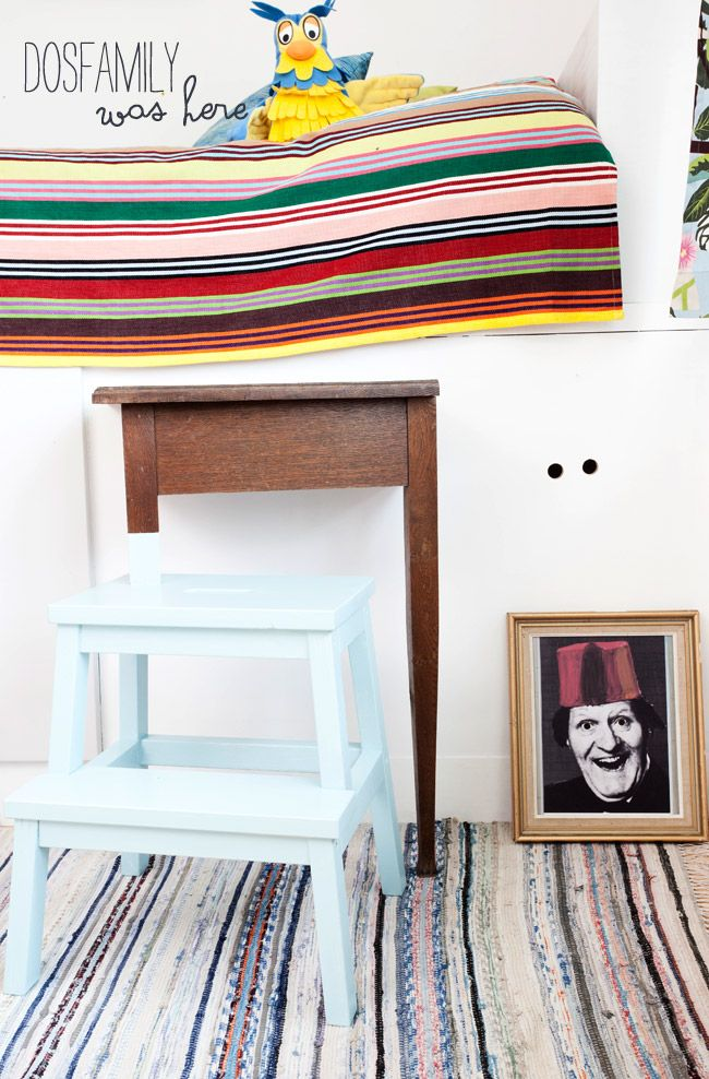 dosfamily: love the stairs Marcus made for the bed: Using an old table and a stepping stool from Ikea. They chose such a fun portrait to spy from. Marcus drilled holes in it and in the board behind.