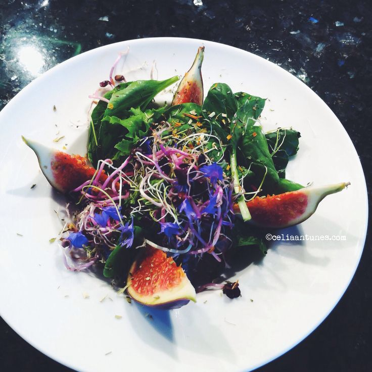 young lettuce leaves and seedlings salad with figs and cornflowers blue