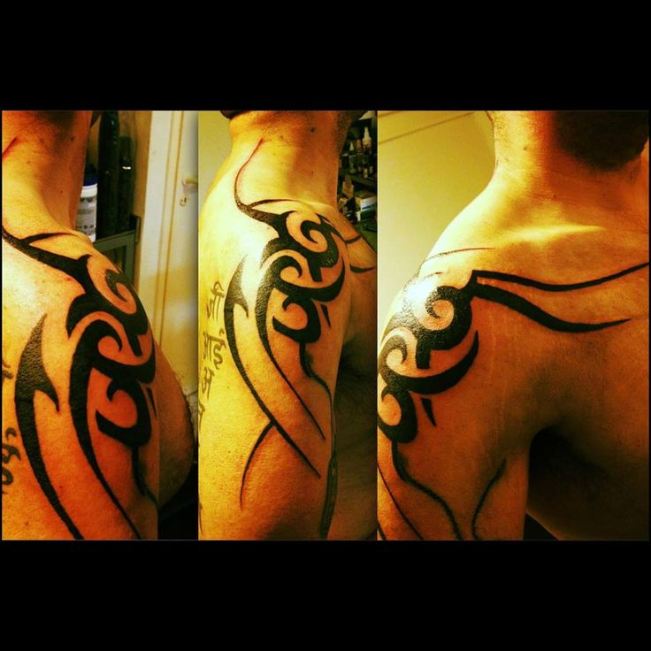 This a tribal arm tattoo. It's a perfect suggestion for men arm tattoo created by Acanomuta Tattoo Studio.
