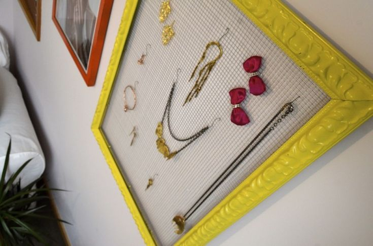 YES! Been looking for a cool DIY jewelry holder for my costume/everday jewlry aand I love frames...perfect!