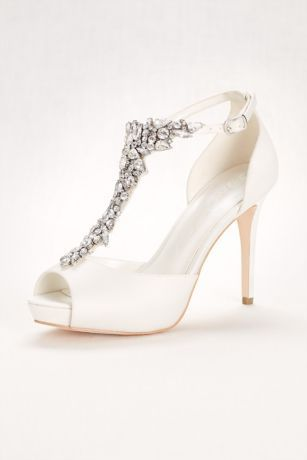 """If you love the beading on Jenny Packham's gowns, you'll fall head over heels with the beaded T-strap on these strut-worthy high heel sandals.  Wonder by Jenny Packham  Satin upper, synthetic insole  Adjustable buckle closure  3.75"""" heel with .5"""" platform  Imported  Fits true to size"""