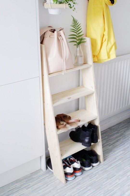 15+ Stylish DIY Projects for Your Entryway - Could adapt and old wooden ladder - turn steps upside down so that shelves slant upwards to prevent shoes from falling off.  Consider backing wall with perspex sheeting to keep the wall behind it clean.